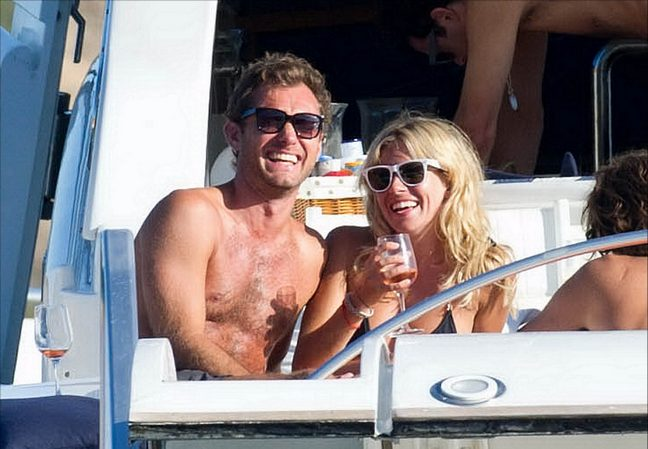 Jude Law, black swim trunks, sunglasses, Sienna Miller, black string bikini, sunglasses, wine glass