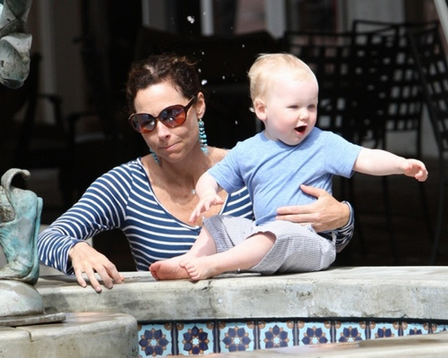 Minnie Driver, blue and white striped top, turquoise dangle earrings, sunglasses,