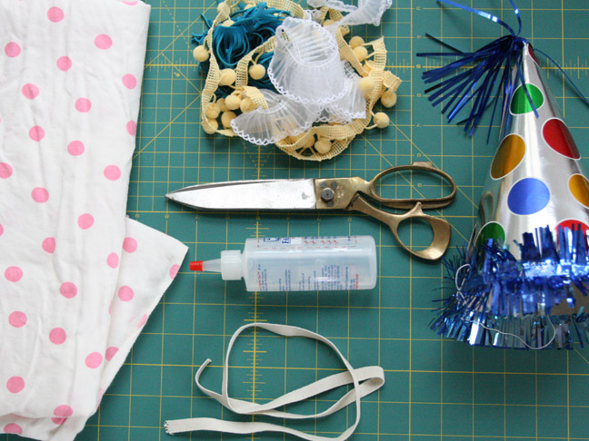 supplies for party hat making include craft glue, scissors and other embellishments