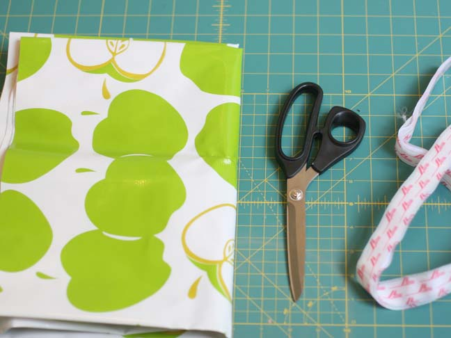 green apple oilcloth scissors on cutting mat