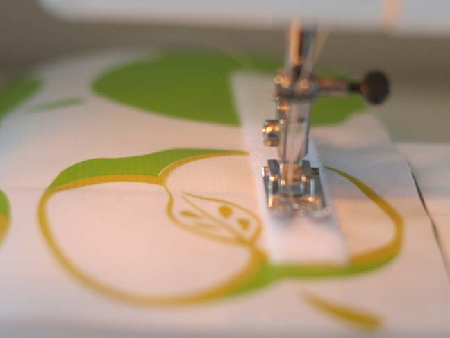 sewing machine sewing velcro on fabric