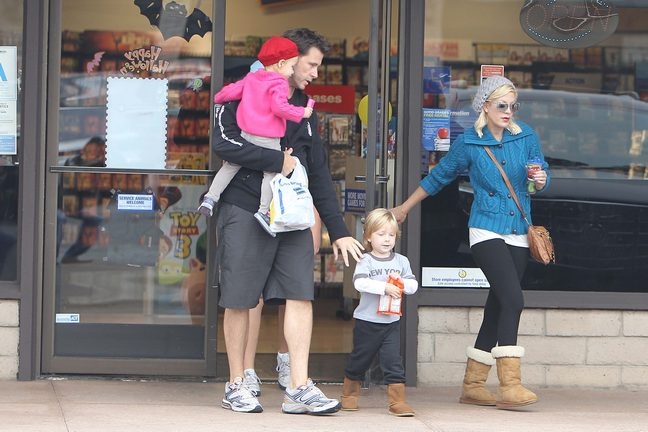 tori spelling,blue jacket, boots, black leggings