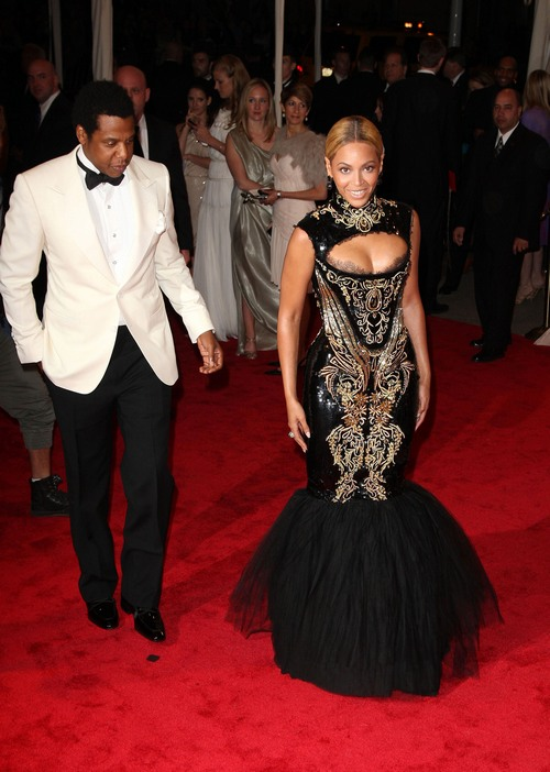 Jay-Z white tux, Beyonce gold and black gown