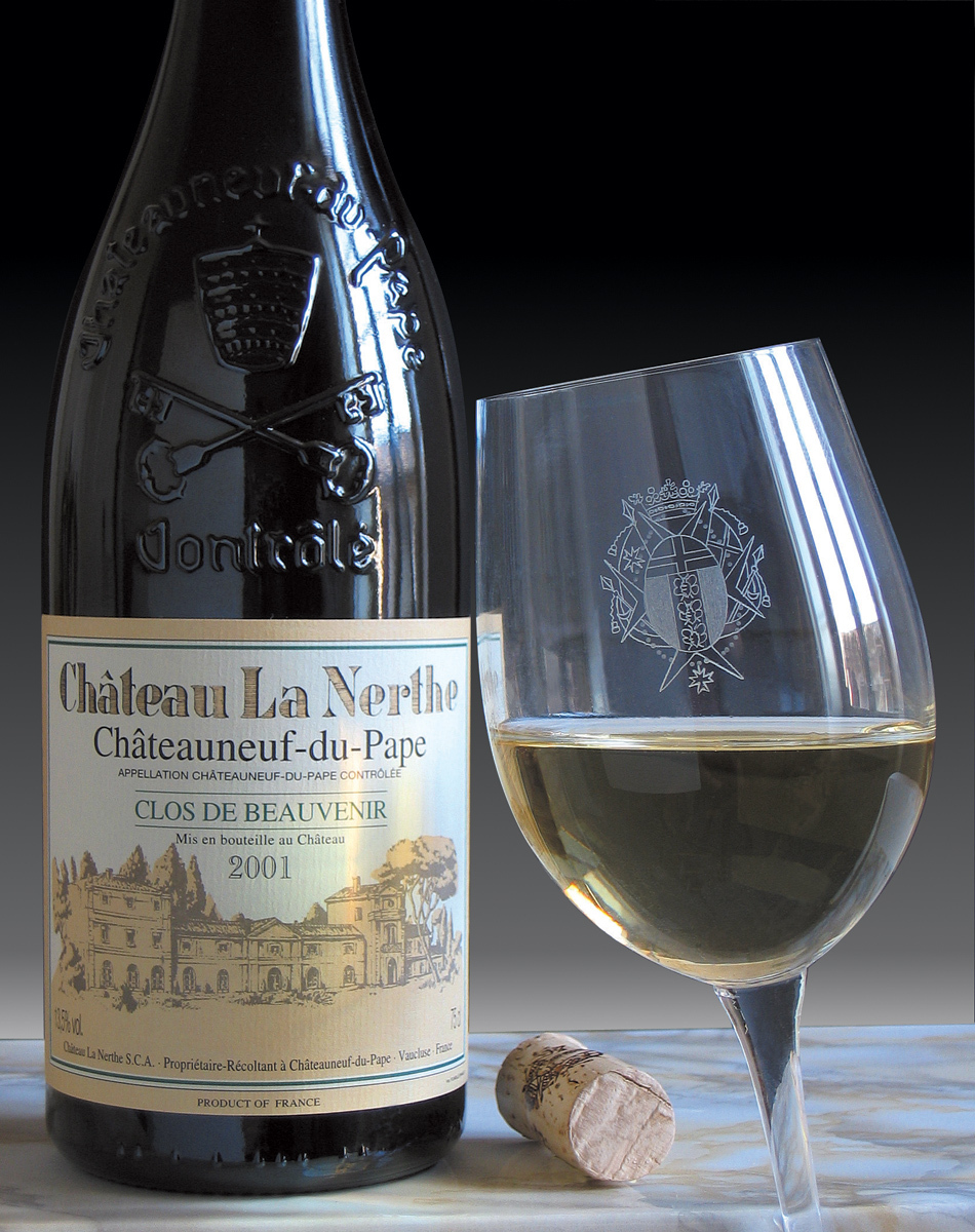 A bottle and glass of chateau du pape