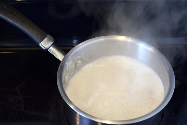 Boiling milk on stove