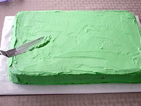 green icing on the bottom layer of the cake