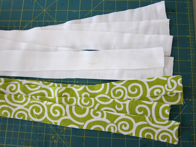 Strips of white and green fabric to be made in to the valance