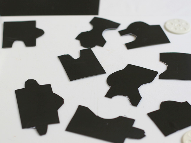 black magnet puzzle pieces