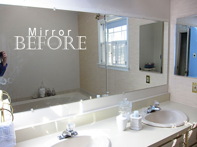 large frameless bathroom mirror before the moulding was added