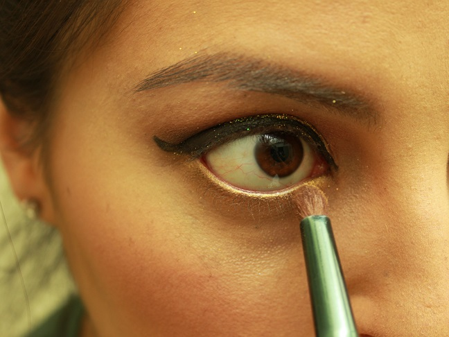 Line Upper Eyes with liner, and lower lash with gold eyeshadow