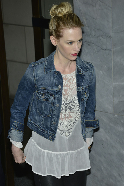 January Jones in a white lace blouse, jean jacket and ballerina bun
