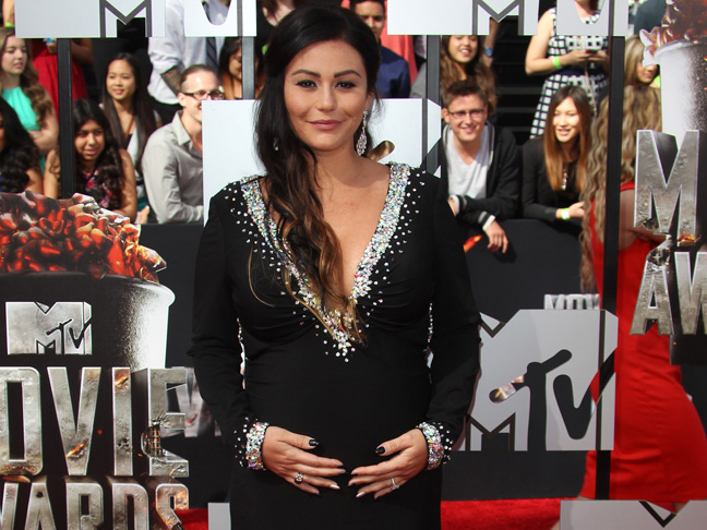 A very pregnant Jenni Farley in a black v-neck gown at the MTV music awards