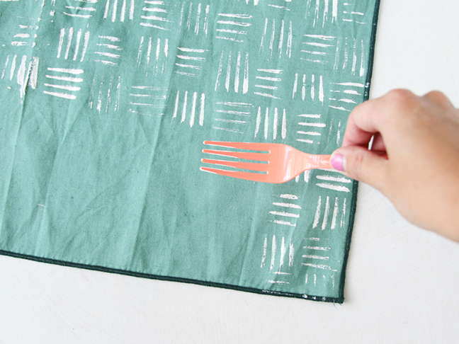 Use a fork to create a hash mark stamp for napkins