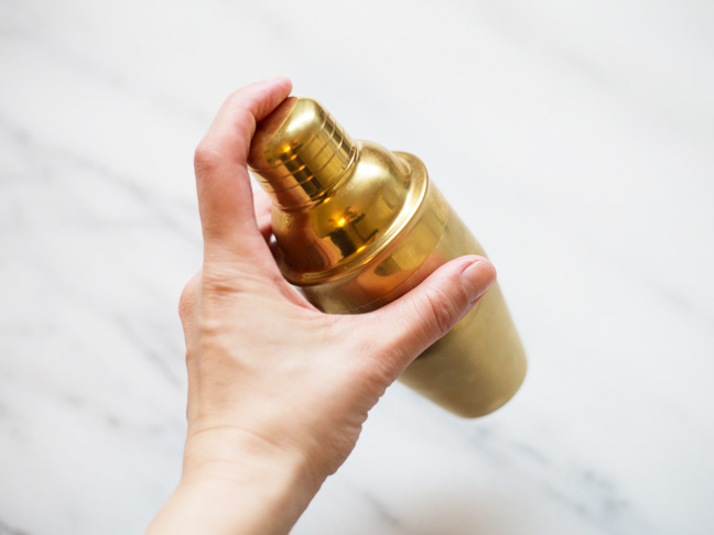 hand-gold-cocktail-shaker