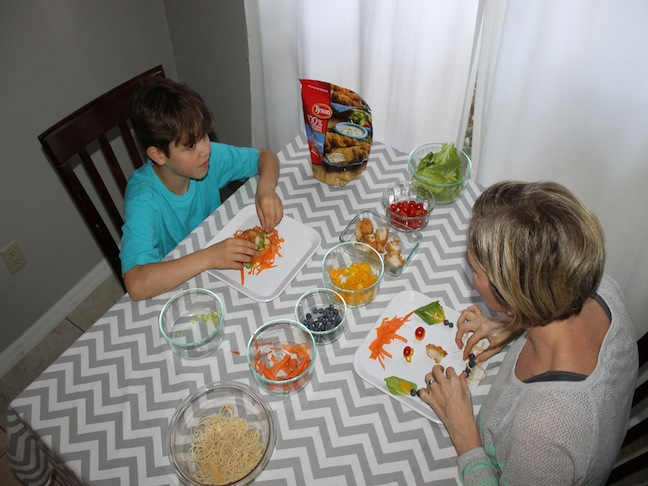 Mother and Son at dinner table talking