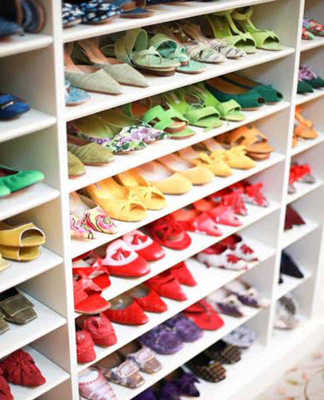 Shoes in closet organized by color