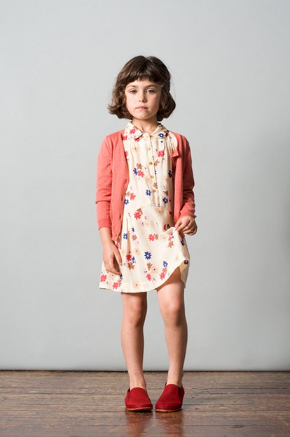 little girl in flower dress with cardigan