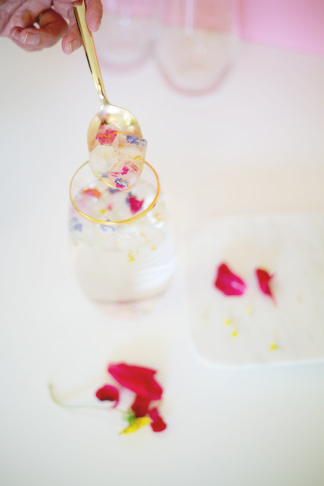 gold-spoon-hand-flower-petal-ice-cubes