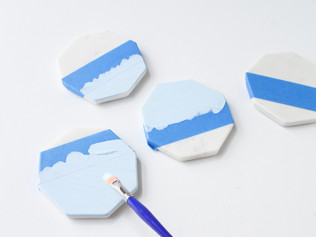 Paint coasters in pastel colors with acrylic paint.