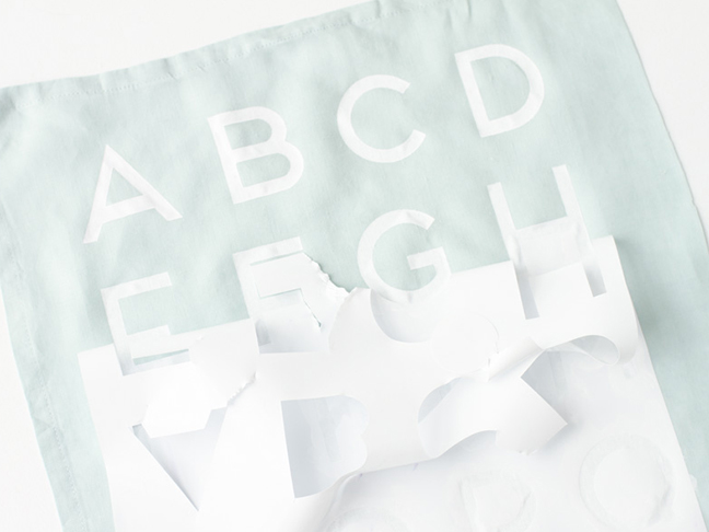 Remove stencil to reveal the finished alphabet tea towel.