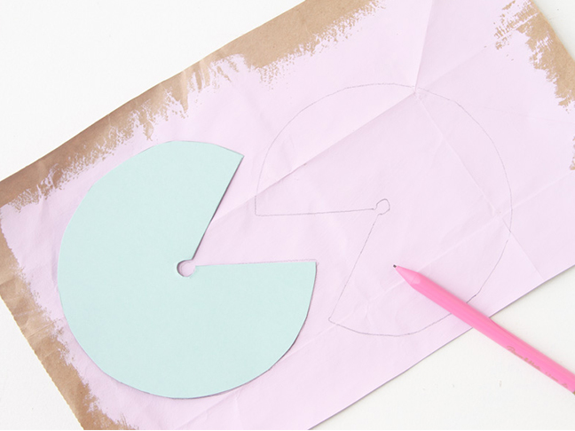 Trace template shape onto paper painted bags