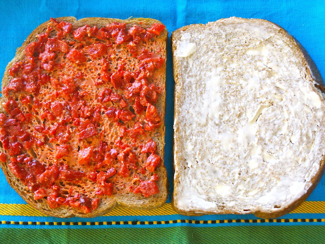 grated cheese-red pepper-toast-blue cloth