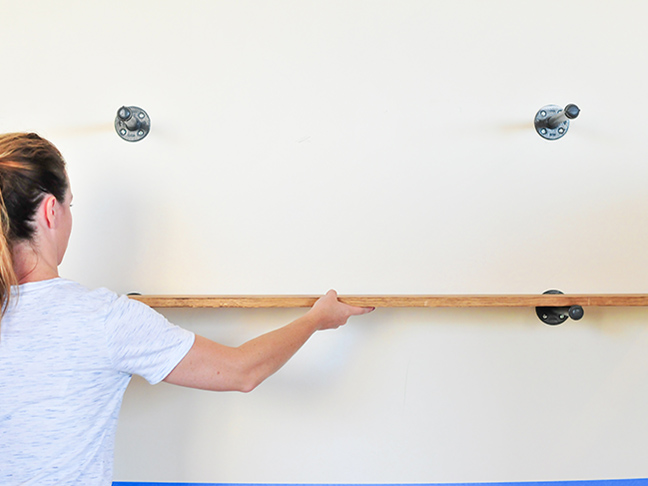 Hanging wood to create industrial wall shelves