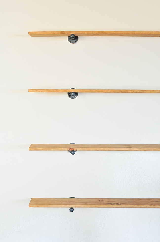 hanging plumbing supplies to create industrial wall shelves