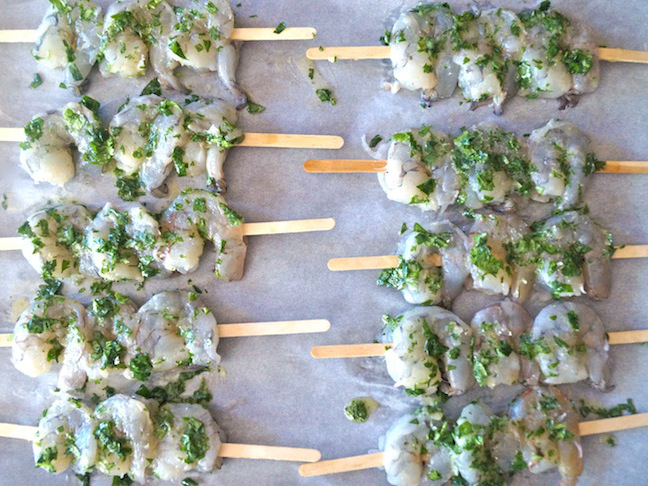 shrimp on wood skewers with cilantro