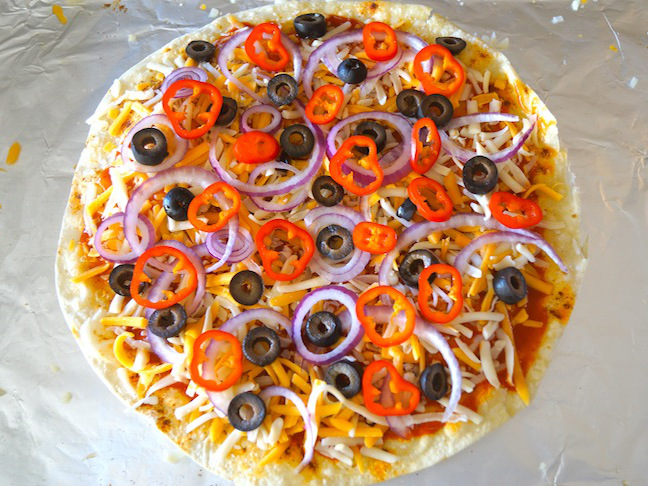 pizza with black olives cheese red onion tortilla