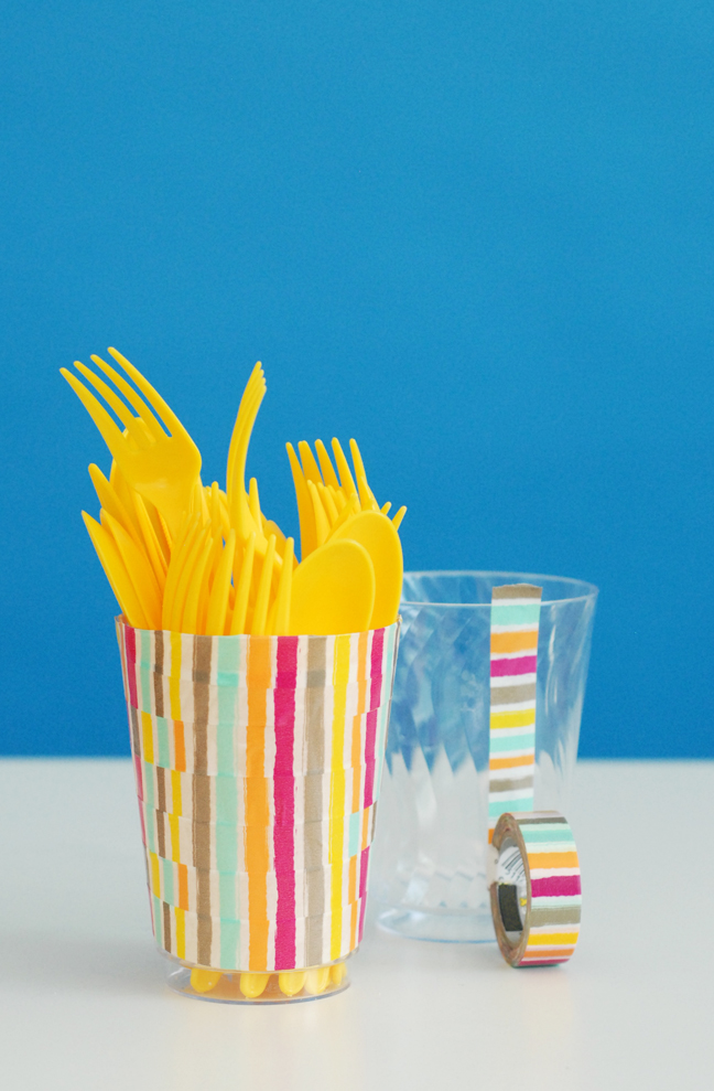 yellow plastic utensils in washi tape cup