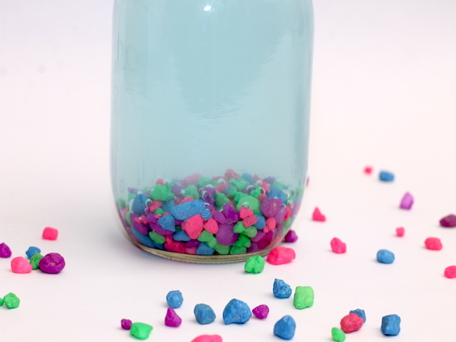 mason jar filled with colourful rocks