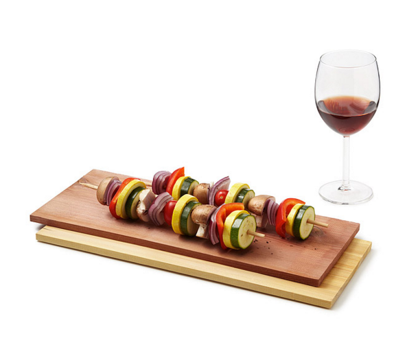 kebabs on wood planks wine glass