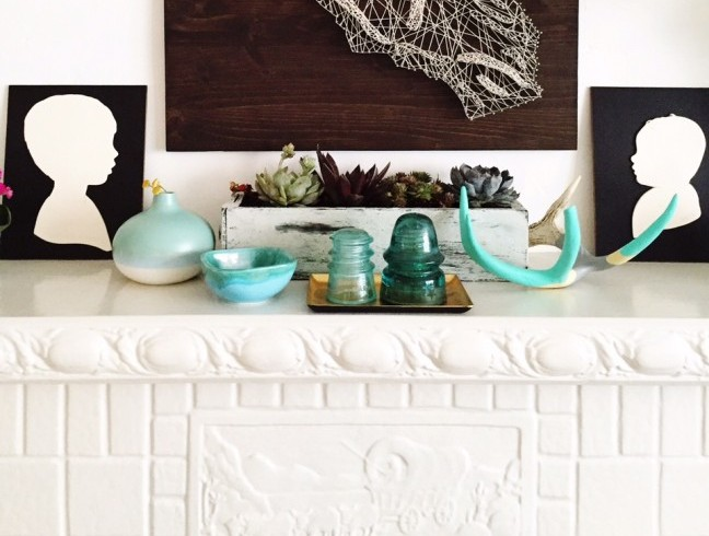 mantle decor with succulent garden and silhouettes