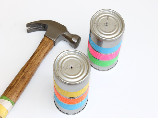 tin cans with hammer