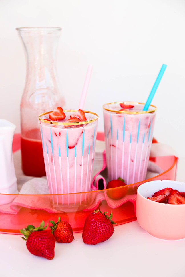 pink strawberry drinks on pink acrylic tray