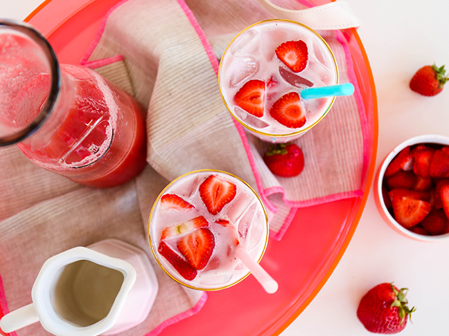 strawberry juice and tea with pink strawberry drinks on tray