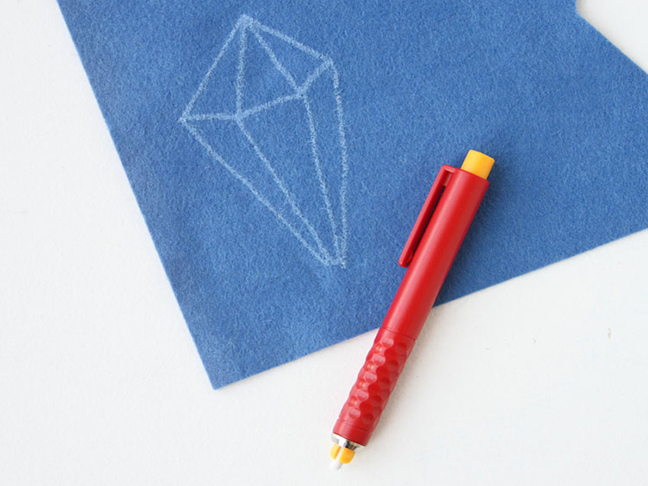 Draw the outline of the geometric shape in chalk