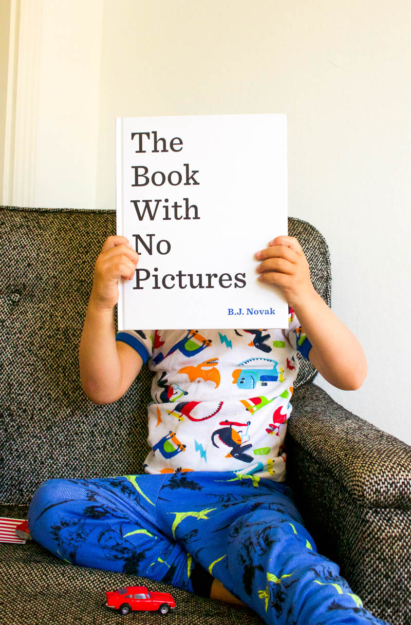 kid holding book with no pictures