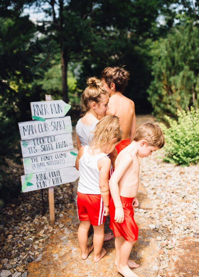 obstacle-course-sign-kids-red-shorts