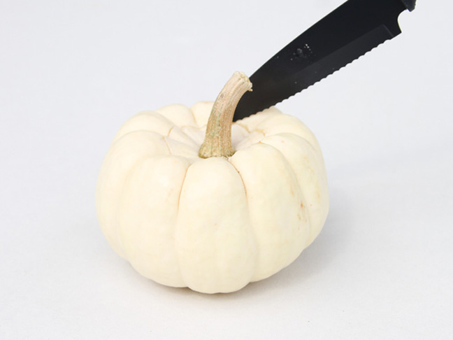 Cut top of pumpkin with knife