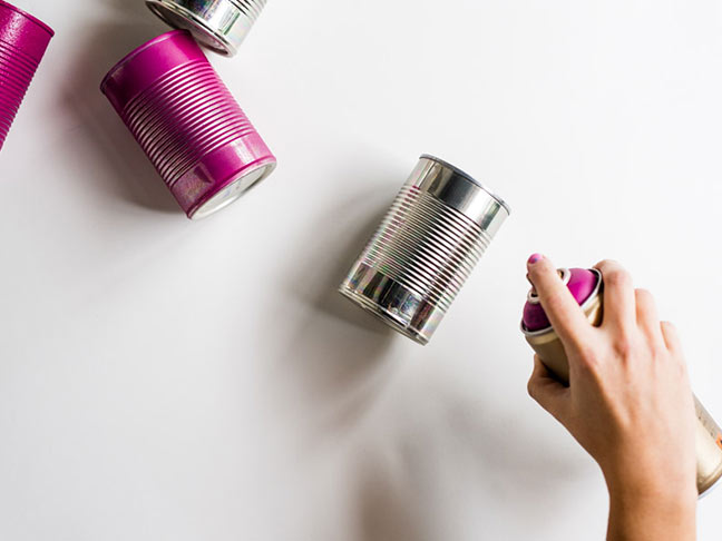 Spray cans with spray paint