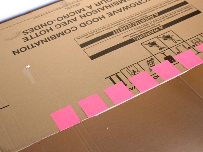 pink-post-it-notes-on-a-cardboard-box