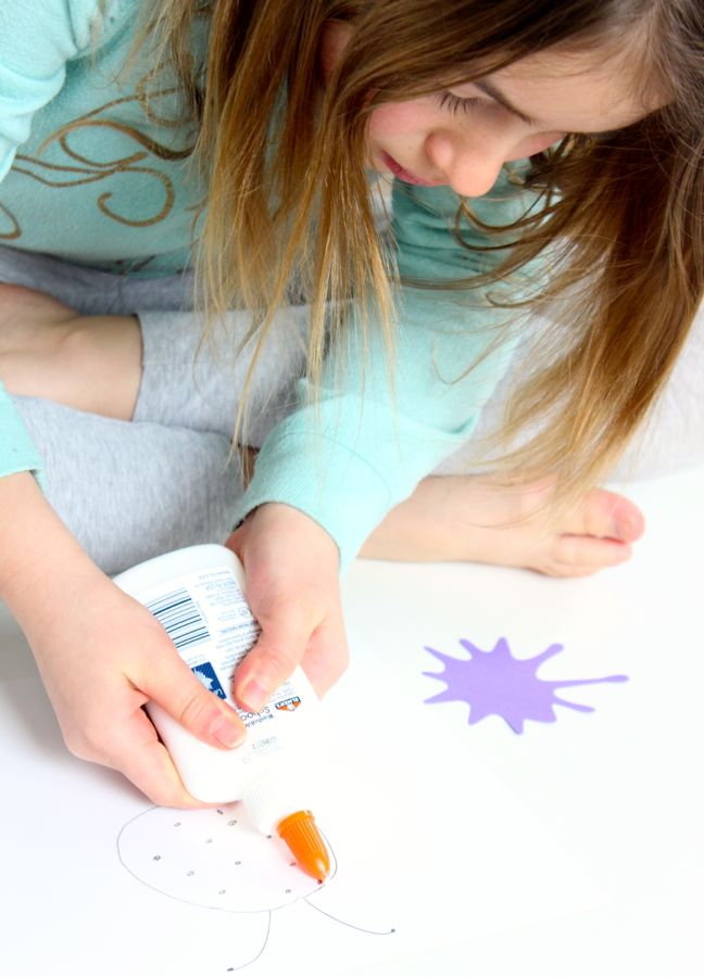 young-girl-doing-art-with-elmers-school-glue