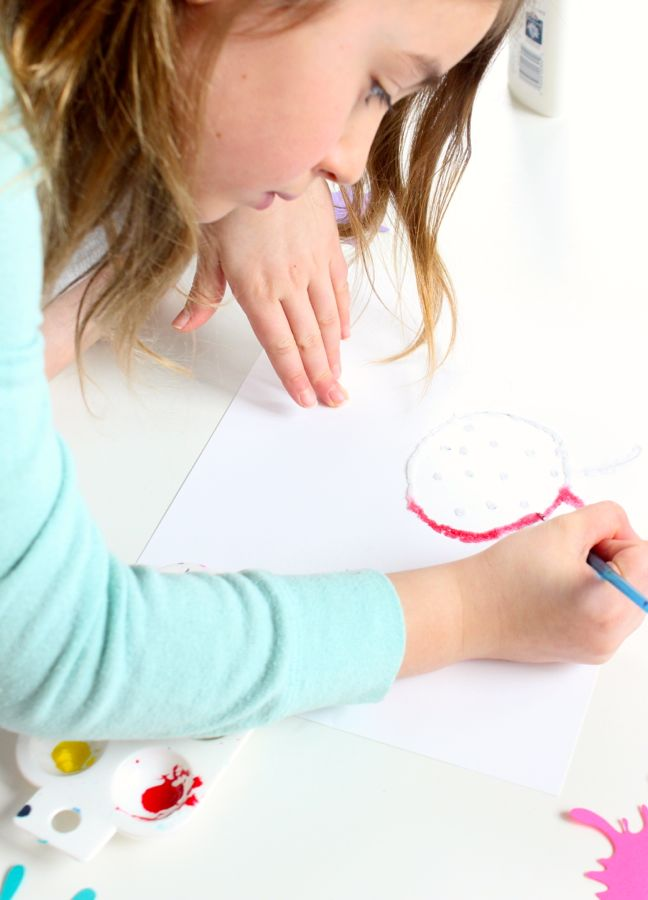 young-girl-painting-with-a-red-ladybug-with-watercolor-paints