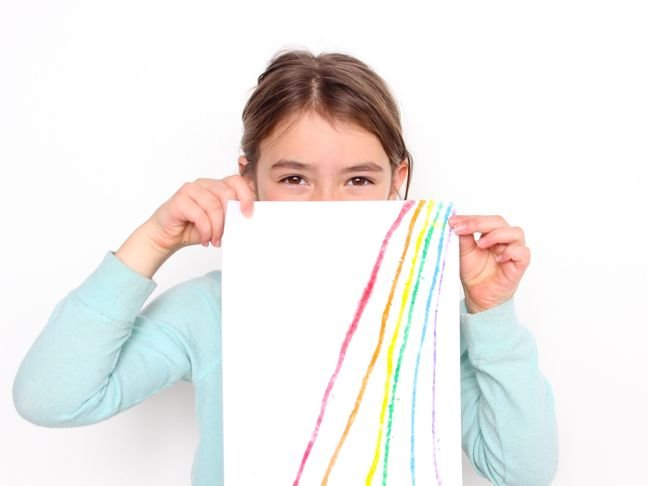 young-girl-holding-up-rainbow-salty-art