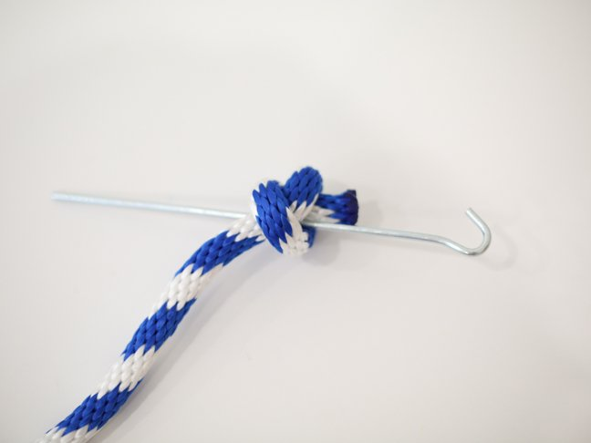 Knotted rope with metal stake
