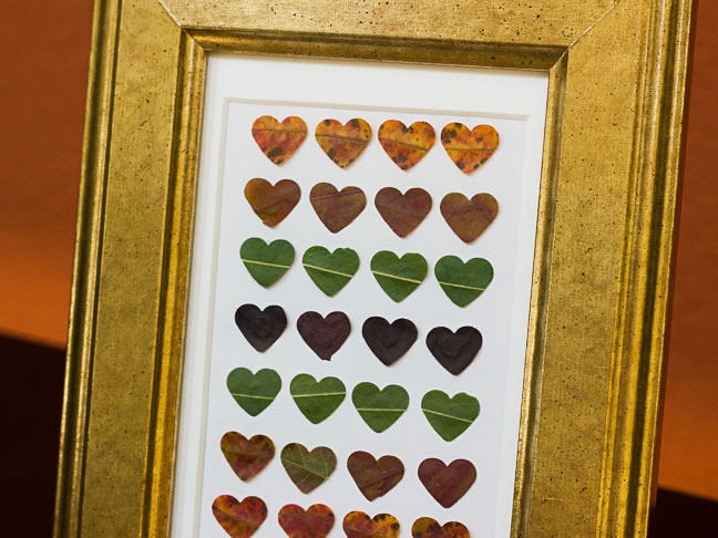 graphic heart art in gold frame