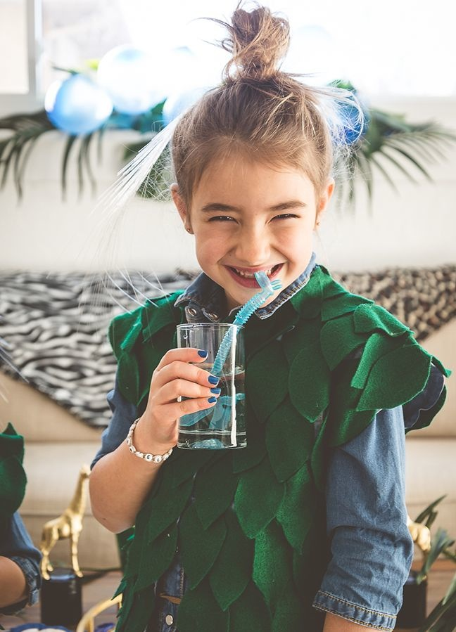 girl-with-leaf-vest-and-blue-giraffe-straws