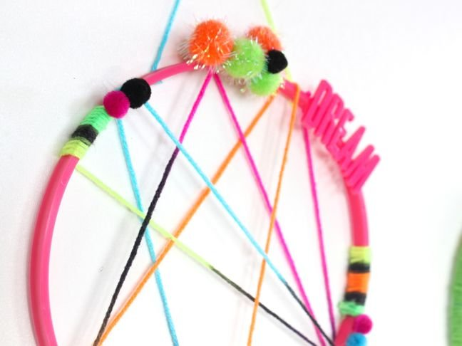 colorful-pink-yellow-blue-green-dream-catcher-for-kids-pom-poms-feathers-sweet-dreams